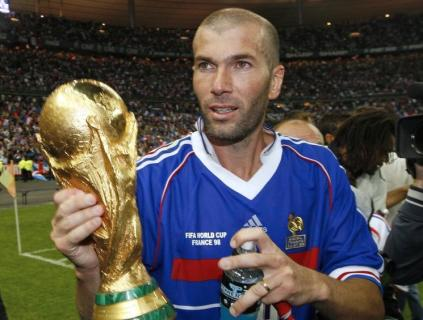 France's Zinedine Zidane holds the World Cup trophy after an exhibition soccer match in Saint Denis